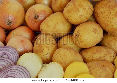 mix of fresh sliced and whole potatoes and onions