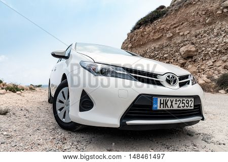 SITIA, CRETE, GREECE - AUGUST 2016: Closeup of Toyota Auris staying among mountains near Sitia town on Crete island, Greece