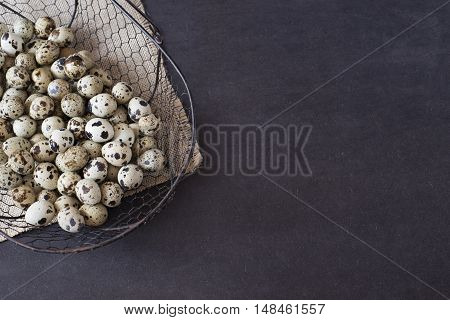 Wire Mesh Basket With Quail Eggs. Dark Food Photography. Rustic Background, Selective Focus And Diff