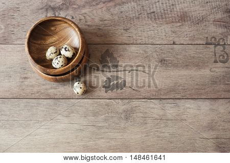Wooden Bowls With Quail Eggs. Rustic Wood Background, Diffused Natural Light. A Different Type Of Co