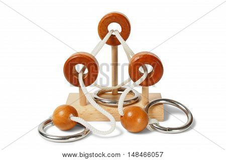 Wooden logic puzzle with rings and strings on white background