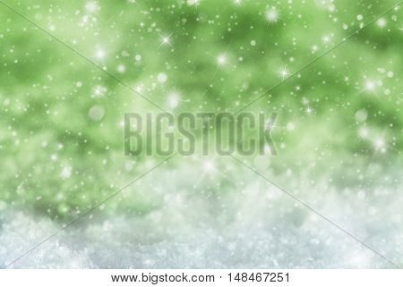 Christmas Texture With Sparkling Stars. Snow And Snowflakes With Green Background. Copy Space For Advertisement. Card For Seasons Greetings