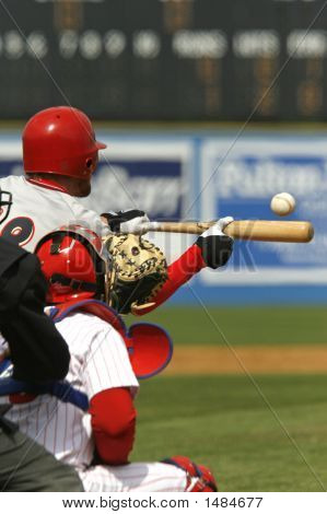 Baseball Player Hitting