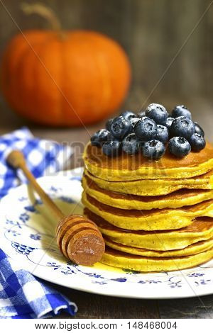 Pumpkin Pancakes With Fresh Blueberry And Honey.