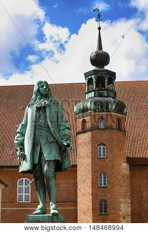 The statue of Chancellor Peder Griffenfeld and a tower in Copenhagen Denmark