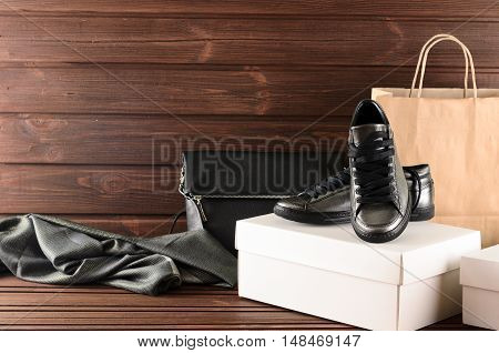 Leather Upper Metallic Trendy Womens Shoes, Scarf And Black Leather Bag On Brown Wooden Background