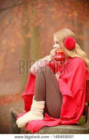 Girl With Cup In Park.