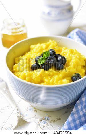 Rice Porridge With Pumpkin And Fresh Blueberry.