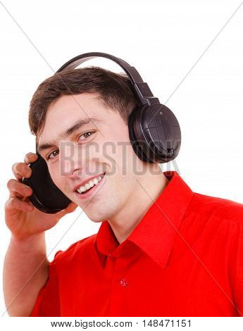 Man in big headphones listening music mp3 closeup. Smiling male model on white. People leisure happiness concept