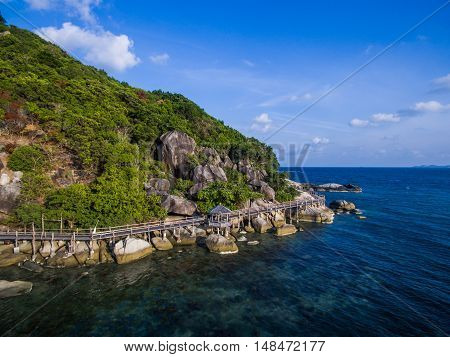 Aerial view on wooden track around the headland on the island Koh Phangan
