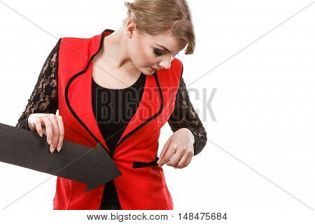 Lack of cash concept. Elegant attractive woman showing by black arrow sign her empty pocket. Girl having no money.