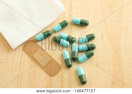 Pill on wooden table,Tablets and capsules on wooden table
