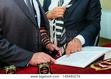 Hand Of Boy Reading The Jewish Torah At Bar Mitzvah