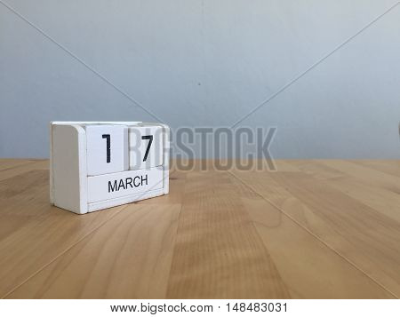 March 17Th. March 17 White Wooden Calendar On Vintage Wood Abstract Background. First Spring Day.cop