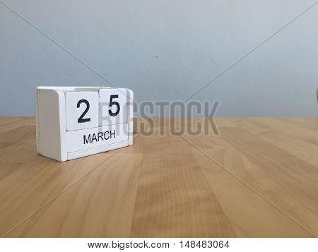 March 25Th. March 25 White Wooden Calendar On Vintage Wood Abstract Background. First Spring Day.cop