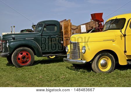 ROLLAG, MINNESOTA, Sept 1. 2016: Several refurbished International trucks are displayed at the West Central Steam Threshers Reunion in Rollag, MN attended by 1000's held annually on Labor Day weekend.