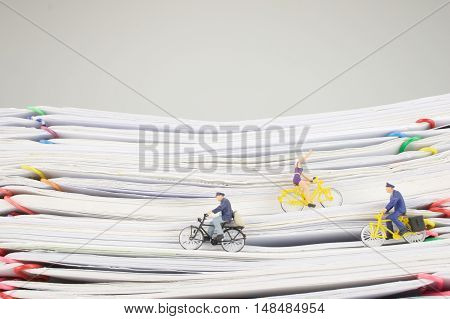 Postmen And Woman Is Cycling On Pile Overload Paperwork