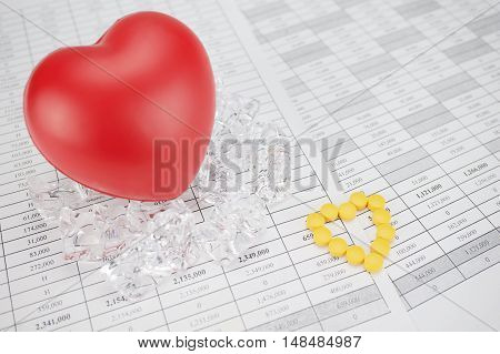 Yellow Pills Place As Heart Shape On Finance Report