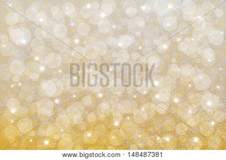Yellow abstract background with bokeh and stars placed on the crystalline texture of snow surface