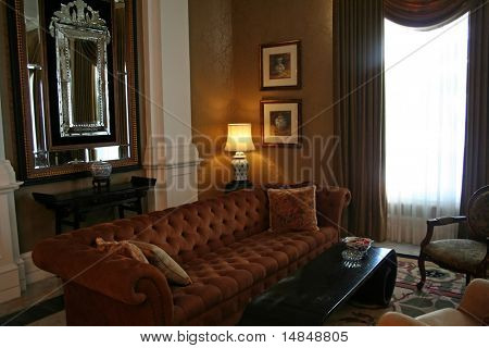 Living room with sofa, in Colonial British style