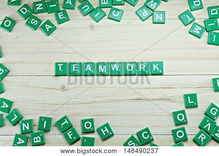 Concept of business : word teamwork on wood background