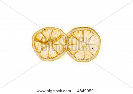 Sun-dried (dried) lemon close up on a white background
