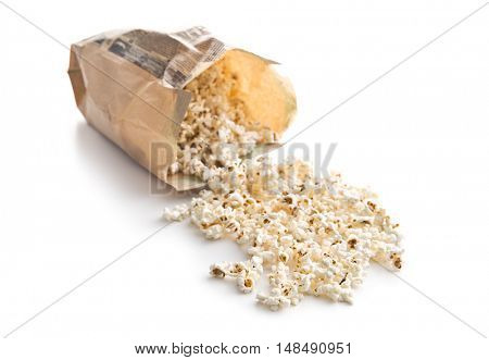Tasty salted popcorn in paper bag isolated on white background.