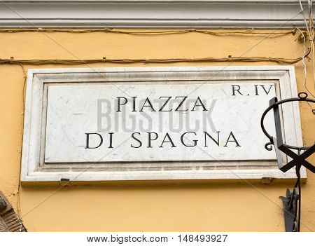 ROME ITALY - JUNE 15 2015: Street plate of famous Piazza di Spagna. Rome. Italy.