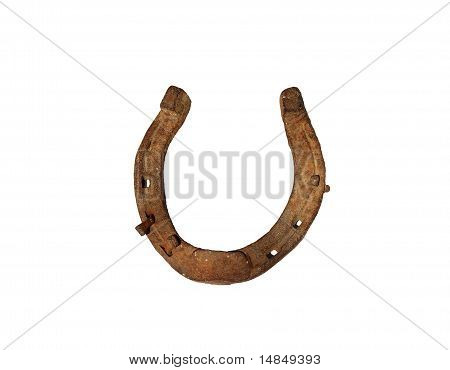 Old rusty horseshoe with nail isolated on white background