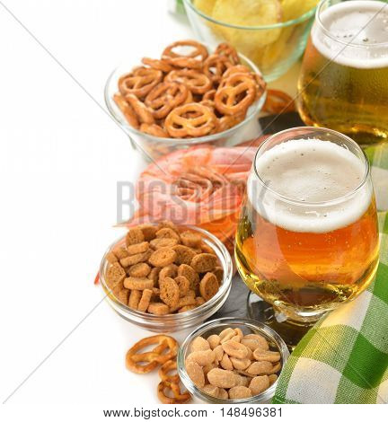 Beer and snacks on a white background