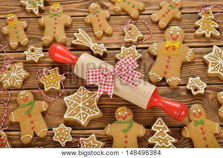 Various Christmas gingerbread on a brown background