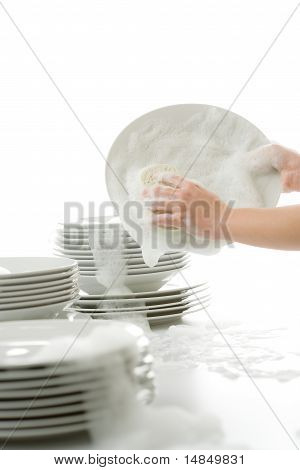 Washing Dishes - Hands With Gloves In Kitchen