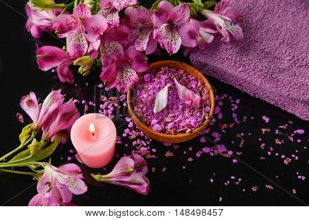 Spa feeling with towel ,salt in bowl ,candle , towel ,orchid