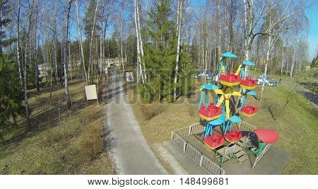 Childrens playground among the trees in a health camp for children, aerial view