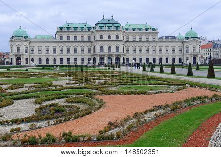 VIENNA AUSTRIA - NOVEMBER 23 2013: The Upper Belvedere Palace with gardens in the foreground. The Baroque palace was built as a summer residence for Prince Eugene of Savoy.