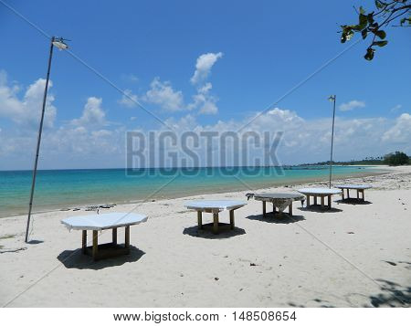 one side of the Tanjung Kelayang beach at Belitung island. used to be used for having outdoor lunch or dinner or beach party. the unique is the artistic way to set the tables.