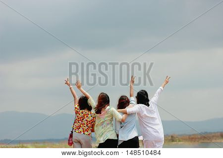 soft and blur focus with Happy woman friends having fun and expressing emotions look at the moutain