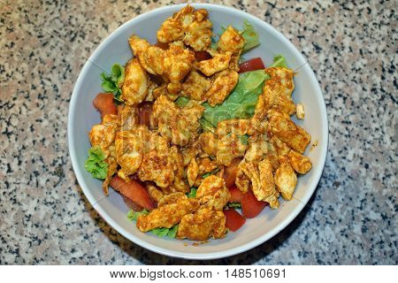 Delicious homemade spicy and healthy chicken salad for recovery food after workout.