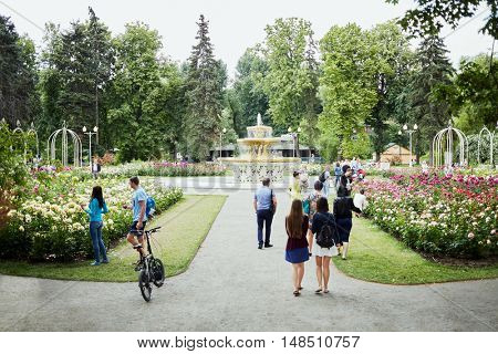 MOSCOW, RUSSIA - JUN 29, 2015: People walk in rosary near fountain in Gorky park. Rosary Fountain was built in the year of the opening of Gorky Park in 1934.