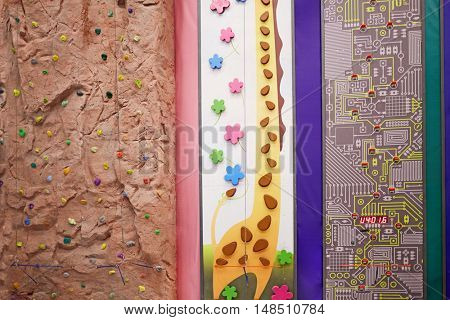 RUSSIA, MOSCOW - DEC 12, 2014: Three climbing walls in the children climbing center FunWall Club. FunWall Club - is a 10-meter complex of interactive attractions, consisting of 17 different modules.