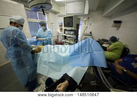 RUSSIA, MOSCOW - 01 SEP, 2015: Doctors are operating knee at the center of endosurgery and lithotripsy.