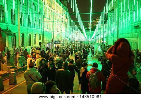 RUSSIA, MOSCOW - 03 JAN, 2015: People are walking in the decorated with glitter garlands boulevard near theater Moscow operetta.