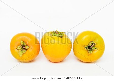 Delicious  RAW Persimmon fruit on white background
