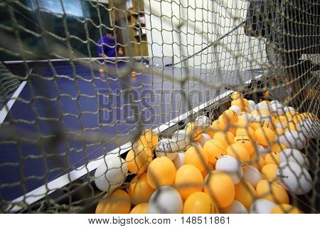 RUSSIA, MOSCOW - 02 APR, 2015: Close up view of automatic assistant with many balls for ping pong.