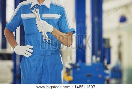 Car mechanic in garage service car center
