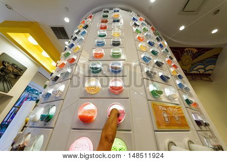 NEW YORK - August 23, 2014: man hand picking bricks at Lego store in Rockefeller center