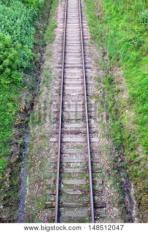 Old railroad tracks in the natural environment in perspective. Top view. Vertical view.