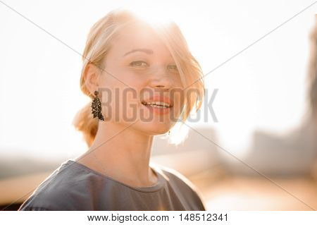 portrait of a blonde girl against sunset