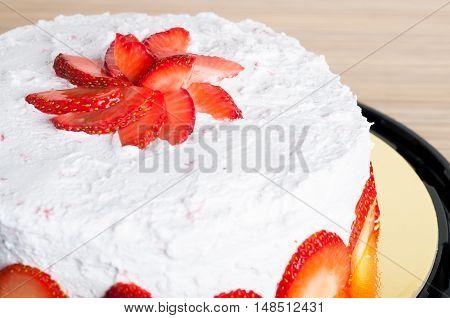 freshly baked moist strawberry shortcake in strawberry cream filling