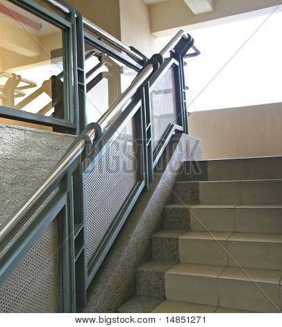 Modern glass and steel staircase reflective